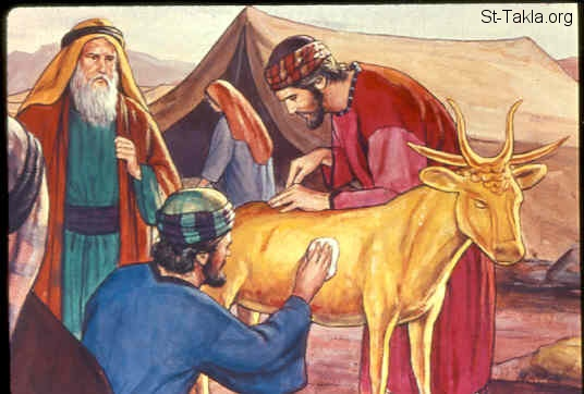 "St-Takla.org Image: And Aaron received the gold from their hand, and he fashioned it with an engraving tool, and made a molded calf. Then they said, ""This is your god, O Israel, that brought you out of the land of Egypt!"" (Exodus 32:4) صورة في موقع الأنبا تكلا: صنع العجل الذهبي (خروج 32: 4)"