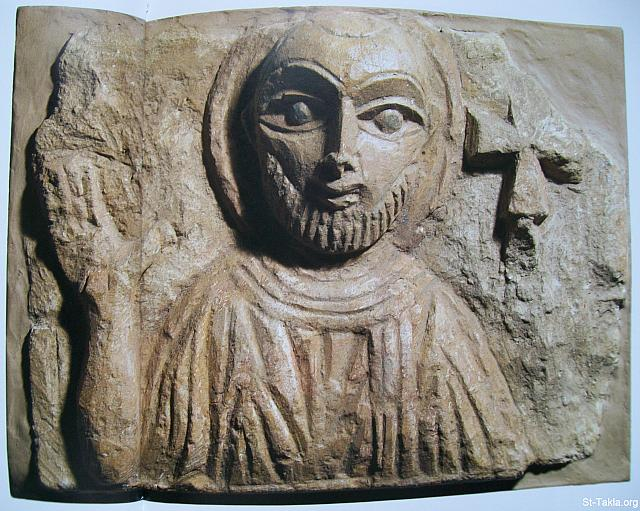 St-Takla.org Image: A face of an Egyptian saint on limestone, where the saint is holding a Cross with His left arm. Unknown origin, dates back to the 4th or the 5th century. ���� �� ���� ������ ����: ��� ���� ��� ��� ��� ����� ������ ���� ���� ���� ������ ��� ����� ������ ������� ��� �� ��� �������ϡ ����� ������ ��� ����� ������ �� ������ ��������.