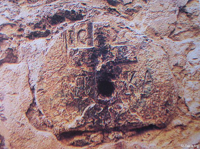 "St-Takla.org Image: A stone at the wall of the Greek Monastery in Jerusalem, with cross engravings, and Latin writings ""Jesus the victorious"". And this stone is put at the place where Jesus was consoling the daughters of Jerusalem that were crying out in grief for Him. صورة في موقع الأنبا تكلا: حجر على حائط الدير اليوناني الحالي بالقدس، منقوش عليه رسم صليب ومكتوب باللغة اللاتينية عبارة ""يسوع المنتصر"". والحجر موضوع عند المكان الذي واسى فيه المسيح بنات أورشليم الذين كانوا يبكون عليه (لو23: 28)."