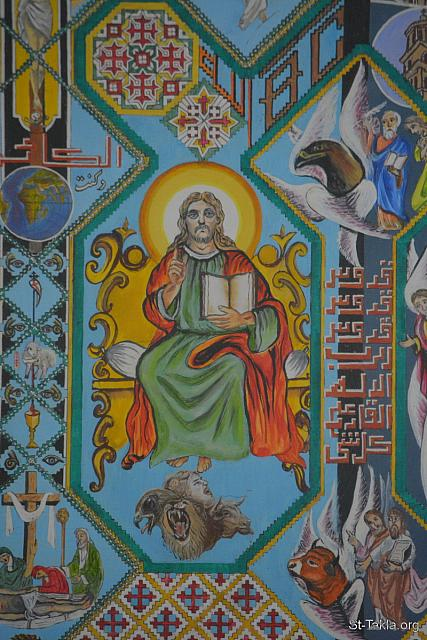 "St-Takla.org Image: Jesus Christ on His throne: ""The four living creatures, each having six wings, were full of eyes around and within. And they do not rest day or night, saying: ""Holy, holy, holy, Lord God Almighty, Who was and is and is to come!"""" (Revelation 4: 8) - Details from the icon of the events of the Apocalypse (Book of Revelation), by Father Makarious Al-Baramousy, Baramous Monastery, Natroun Valley, Egypt - Photograph by Michael Ghaly for St-Takla.org, October 21, 2018. صورة في موقع الأنبا تكلا: السيد المسيح على العرش: ""والأربعة الحيوانات لكل واحد منها ستة أجنحة حولها، ومن داخل مملوة عيونا، ولا تزال نهارا وليلا قائلة: «قدوس، قدوس، قدوس، الرب الإله القادر على كل شيء، الذي كان والكائن والذي يأتي»"" (الرؤيا 4: 8) - تفاصيل من أيقونة أحداث سفر رؤيا يوحنا اللاهوتي، رسم الأب الراهب مكاريوس البرموسي، مضيفة دير البراموس، وادي النطرون، مصر - تصوير مايكل غالي لموقع الأنبا تكلاهيمانوت، 21 أكتوبر 2018 م."