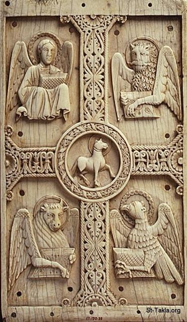 St-Takla.org Image: The painting of the Metropolitan museum: an ivory cross with the four creatures resembling a lamb, a lion, a human, and an eagle at its four ends. صورة في موقع الأنبا تكلا: لوحة متحف المتروبوليتان: صليب من العاج وفى أركانه الأربعة الكائنات الأربعة بالوجوه الأربعة بشبه الكبش والأسد والإنسان والنسر.