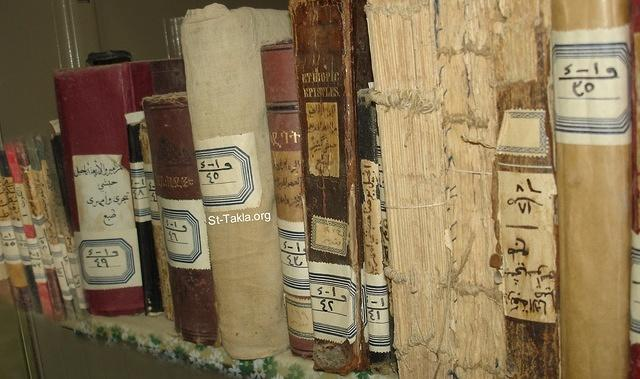 St-Takla.org Image: Ancient and old book from a Coptic Orthodox library at one of the Egyptian monasteries ���� �� ���� ������ ����: ��� ����� ������ �� ����� ����� ��������� ���� ������� �������