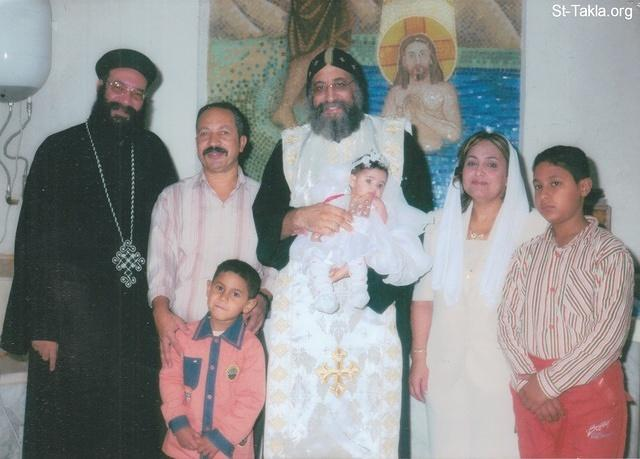 St-Takla.org Image: His Grace Bishop Tawadros General Bishop of Beheira (later: His Holiness Pope Tawadrous II, #118) taking a photo with a family of a baptized baby girl (Irene Fady Mikhail), late 2008 or 2009 - added with permission of the family صورة في موقع الأنبا تكلا: نيافة الحبر الجليل الأنبا تواضروس الأسقف العام بالبحيرة (لاحقًا: قداسة البابا تواضروس الثاني 118) يأخذ صورة تذكارية مع عائلة طفلة قام بتعميدها (إيريني فادي ميخائيل) في أواخر 2008 أو 2009 - موضوعة بإذن الأسرة