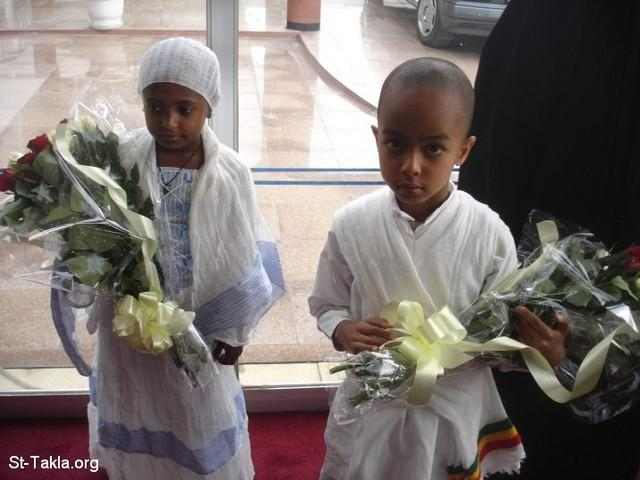 St-Takla.org Image: Beautiful Ethiopian kids: a girl and a boy, to give flowers to Pope Shenouda upon His arrival - from St-Takla.org's Ethiopia visit (waiting for Pope Shenouda III at Addis Ababa Airport), Photograph by Michael Ghaly for St-Takla.org, April-June 2008 صورة في موقع الأنبا تكلا: طفل وطفلة جميلان من الأحباش سيقدمون الورود إلى البابا شنوده حال وصوله - الوفد الحبشي والقبطي في مطار أديس أبابا في انتظار وصول طائرة قداسة البابا شنوده الثالث إلى أديس أبابا في إبريل 2008 - تصوير مايكل غالي لموقع الأنبا تكلاهيمانوت (من رحلة موقع الأنبا تكلا إلى إثيوبيا)، إبريل - يونيو 2008