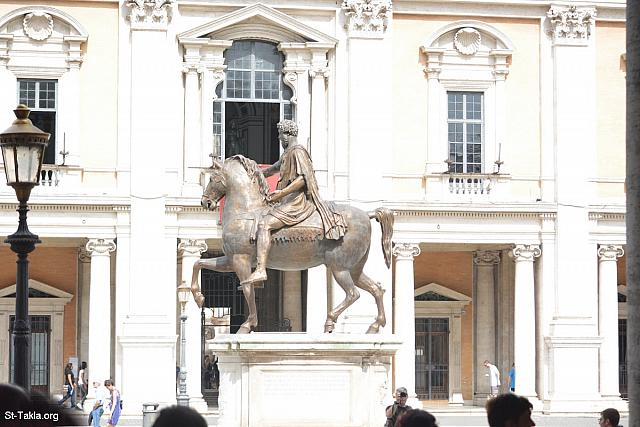 St-Takla.org Image: Replica made on 1981 from the Equestrian statue of Marcus Aurelius giving an address to his army from above his horse (Adlocutio by the Roman emperor), bronze, height: 4.24 m (13.9 ft), (photo 2) - Capitoline Museums (Musei Capitolini), Rome, Italy. It is located in Piazza del Campidoglio, on top of the Capitoline Hill. It was established in 1734. - Photograph by Michael Ghaly for St-Takla.org, September 21, 2014. صورة في موقع الأنبا تكلا: نسخة صُنِعَت سنة 1981 من تمثال برونزي يصور ماركوس أوريليوس (مرقس أوريليوس أنطونينوس أوغسطس) وهو يخاطب جيشه من فوق حصانه، طول 4,24 م. (صورة 2) - صور متاحف كابيتوليني، روما، إيطاليا. وهو مجموعة متاحف في متحف واحد، موجود في أعلى تل كاپيتوليني، وأنشئ عام 1734 م. - تصوير مايكل غالي لموقع الأنبا تكلاهيمانوت، 21 سبتمبر 2014.