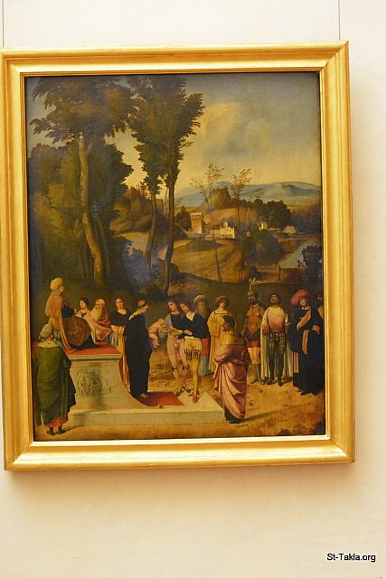 St-Takla.org Image: The Test of Fire of Moses (an episode from the Talmud), painting by Giorgione (1500-1501), oil on panel, 89 cm × 72 cm (35 in × 28 in) - Uffizi Gallery (Galleria degli Uffizi), Florence (Firenze), Italy. It was established in 1581. - Photograph by Michael Ghaly for St-Takla.org, October 1, 2014. صورة في موقع الأنبا تكلا: لوحة قصة تجربة النار لموسى النبي (مشهد من التلمود)، رسم الفنان جيورجيوني (1500-1501)، زيت على لوح بمقاس 89×72 سم. - صور متحف معرض أوفيتزي (متحف أوفيزي)، فلورنسا (فيرينزي)، إيطاليا. وقد أنشئ عام 1581 م. - تصوير مايكل غالي لموقع الأنبا تكلاهيمانوت، 1 أكتوبر 2014