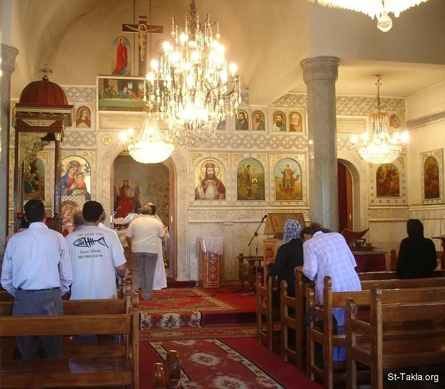 St-Takla.org Image: Some people (men and women) attending the Holy Liturgy (mass) at St. Mary Coptic Orthodox Church, at Saint Mina Monastery, Mariout, Alexandria, Egypt - Date of photo: October 2009