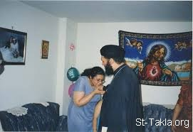 Image: Coptic Priest woman blessing