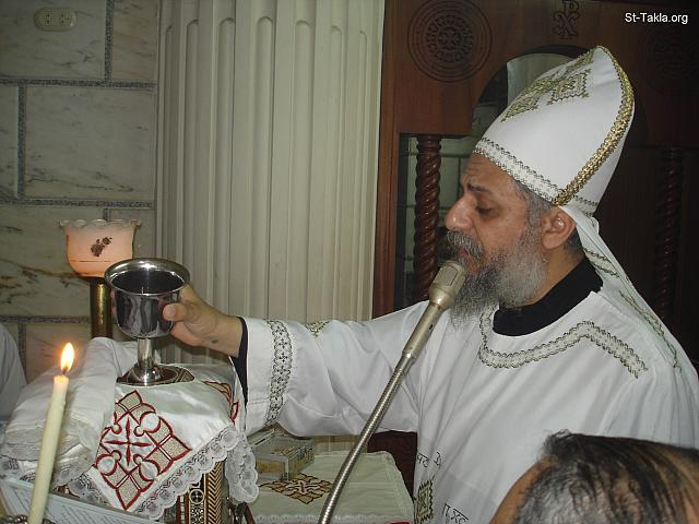 "St-Takla.org Image: The Priest tilting gently the Holy Cup as the Cross sign, while saying: ""Take, drink from it"" - from the Holy Liturgy by Father Karas Ibrahim, the priest of Saint TaklaHaymanout Coptic Orthodox Church, Ibrahimia, Alexandria, Egypt - Photograph by Michael Ghaly for St-Takla.org ���� �� ���� ������ ����: ���� ������ ���� ����� ��� ���� ������ ���� ��� ����: ""���� ������ ����"" - �� ���� ����� ���� ����� ������� ���� ����� ������ ����������� ������� ����������� ������������ ����������ɡ 12 ���� 2012 - ����� ����� ���� ����� ������ ����"