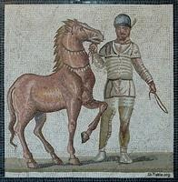 Image: Charioteer of the Albata faction Roman 3rd century Villa dei Severi at Baccano صورة فسيفساء سائق مركبة، روما