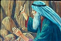Image: Then Moses lifted his hand and struck the rock twice with his rod<br>صورة موسى يضرب الصخرة