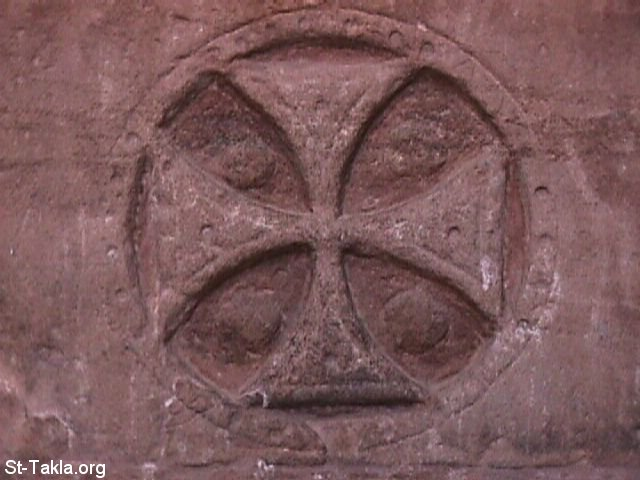 St-Takla.org Image: Photo of a Coptic cross carved (engraved) on wall of temple to Isis at Philae, in Upper Egypt. Ancient temples were converted to use in Christian worship ���� �� ���� ������ ����: ���� ���� ���� ����� ��� ����� ���� ����� �� ���� �� ���� ���. ���� ������� ������� ��� ��������� �������� ������� ��������� �� ������� ��������