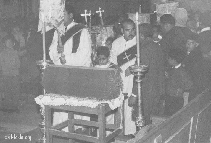 St-Takla.org Image: Deacons holding the cross at the old St. Takla Haymanot Church, Alexandria, Egypt (1970s) ���� �� ���� ������ ����: ������ ������ ������ �� ����� ������ ����������� ������� ����������ɡ ��� (�� ���������)