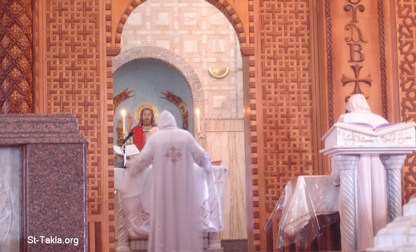 St-Takla.org Image: A Coptic Bishop (and a monk) praying the Liturgy at St. Mina Monastery, Mariout, Alex, Egypt (H. G. Bishop Botros) ���� �� ���� ������ ����: ���� ���� ���� ������ ������ (�� ����) �� ��� ������ ������ǡ ����ء ���������ɡ ��� - ������ ���� ������ �����