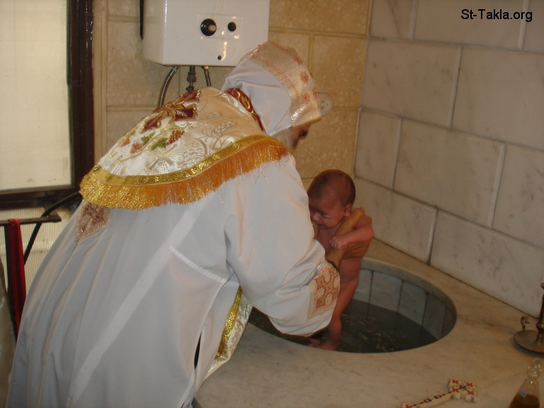 St-Takla.org Image: A Coptic Bishop baptizing an infant at St. Takla Himanot Church Baptistery, Alexandria, Egypt ���� �� ���� ������ ����: ���� ���� ���� ���� ��� ���� �� ������� ����� ���� ����������� ������� ����������ɡ ���������ɡ ���