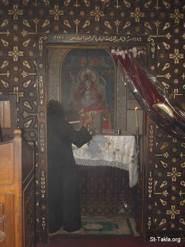 St-Takla.org Image: A Coptic Orthodox Priest Monk raising incense in a Church at St. Mina Monastery, Marriott, Egypt ���� �� ���� ������ ����: ���� ���� ���� ���� �������� ���� ����� ��� ������ �� ����� ���� ������ ���� ������ ����ء ���