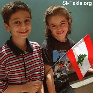 St-Takla.org Image: A boy and a girl carrying Lebanon flag ���� �� ���� ������ ����: ��� ���� ������ ��� �����