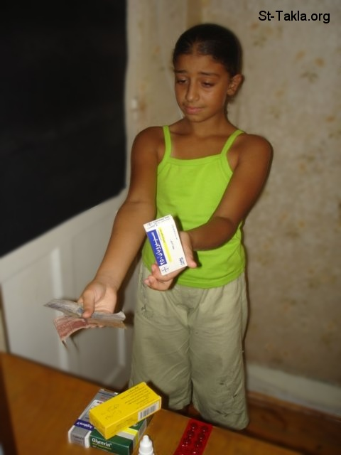 St-Takla.org Image: A girl buying a medicine ���� �� ���� ������ ����: ���� ����� ����