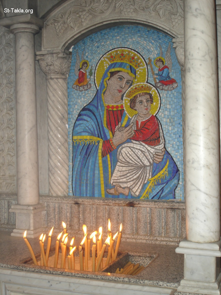 St-Takla.org Image: Mosaic icon of Virgin Mary Mother of God Jesus - Lighting candles in front of St. Mary's mosaic, at St. Mina Monastery, Mariout, Egypt ���� �� ���� ������ ����: ���� ������� ���� ������� ���� - ����� ������ ���� ������ ����� ����� ���� ��������ߡ ��� ������ǡ �����ء ���