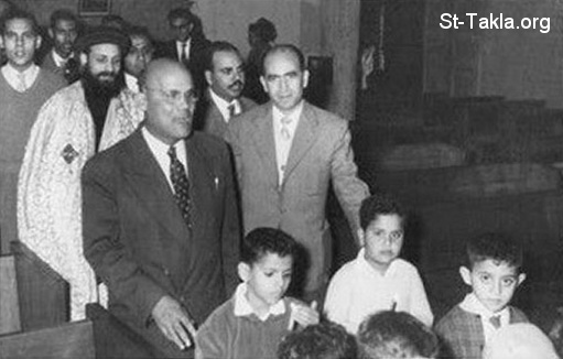 St-Takla.org Image: The Late Mr. Youssef Habib in the early sixties of the 20th century at the Church as cantor, with the late Father Pishoy Kamil of St. George Sporting Church, Alexandria, Egypt ���� �� ���� ������ ����: ������� ������� ���� ���� �� ����� �������� �� ����� ������� �� ������� ����� �� ������� ����� ����� ����� ���� ���� ����� ������� ��������̡ ���������ɡ ���